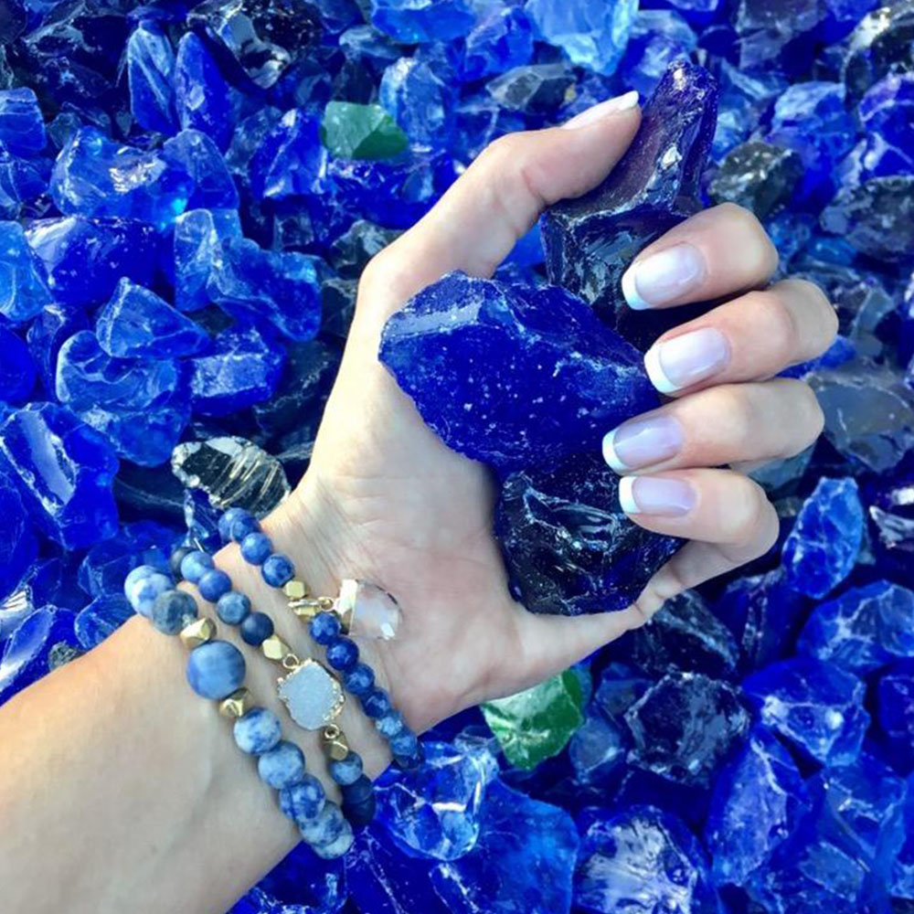 vivid deep blue colored rock crystal stones made into jewelry bracelet
