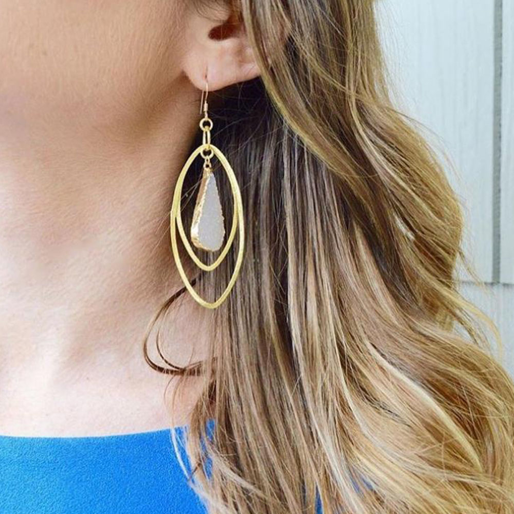 woman wearing fancy geode druzy earrings from chakra boutique