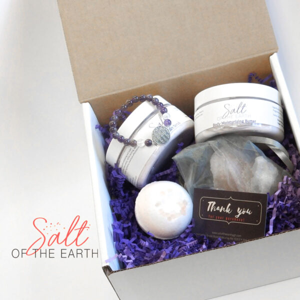 large gift package including lotion, body scrub, bath bomb, salt chunks and a bracelet