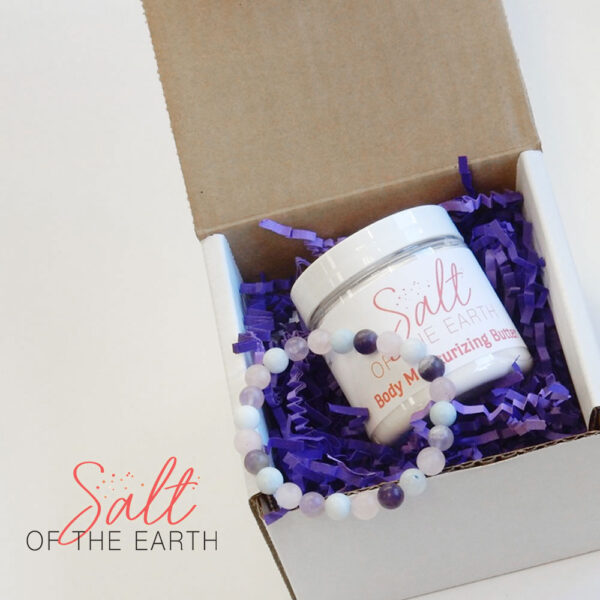 gift box with small lotion and bracelet