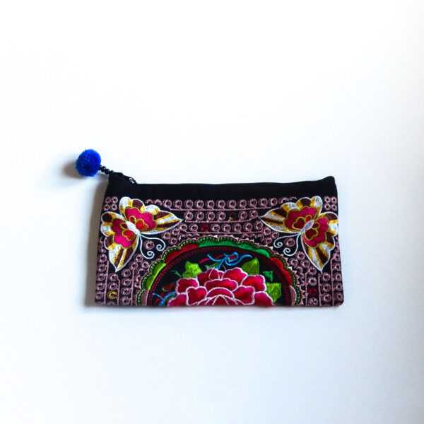 embroidered bag in bright pink, blue and green colors with butterfly and flower detail