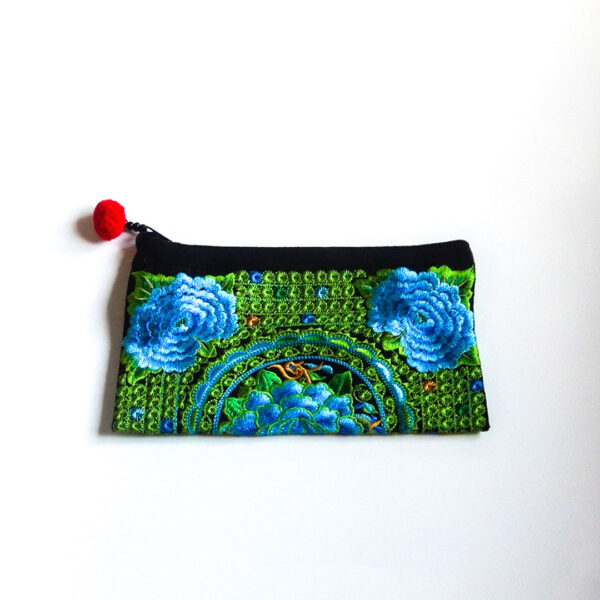 embroidered bag in bright green and blue colors with flower details