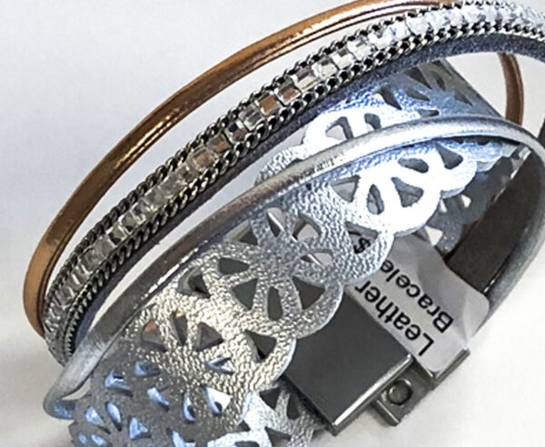 rhinestone and chain detail of silver leather bracelet