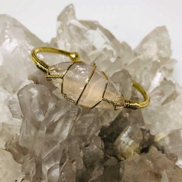 rose quartz crystal bracelet on clear quartz crystal piece